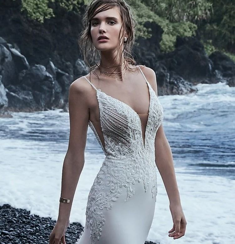 Woman on beach in wedding gown